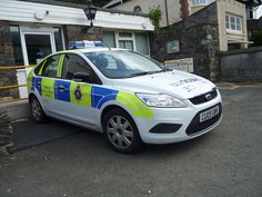 A Welsh Ford Police Car parked up at it's station.