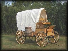 """Covered  Wagon  $ 5000  Canvas Top  Timken Roller Wheel Bearings  Kiln Dried Northern Pine Construction  1 1/8"""" Flat Top Rubber Tired Wheels          OPTIONAL    8"""" Hydraulic Brakes - $400  Barrel (each) - $165  Pole (For Team Use) - $340  Draft Horse Package - $540  Draft Size Shafts - 1 1/2"""" Wheels - 1 1/4"""" Axles/Wheels  Oak Hardwood - $450  10"""" Hydraulic Brakes (Used With Draft Package) $425  Rear Bench Seats $335  $7000"""