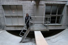 Tetyana Chorna inside the Epcor Tower's earth tube – 19,000 litres of air per second is prewarmed in the 100-metre long concrete earth tube beneath the parkade of the building. http://www.greenenergyfutures.ca/episode/54-amazing-earth-tube