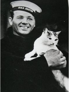 Herbert Chalkley disembarking from HMS Exeter after victory at The Battle of the River Plate in December 1939. He was awarded the Distinguished Service Medal for saving lives, including the life of Scouse, the ship's cat.