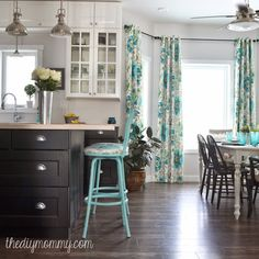 House of Turquoise: The DIY Mommy; I love her idea for hanging curtains in a bay window area.  This would look perfect in our great room.