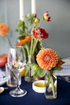 Red and Orange Flowers with Navy Red orange & yellow flowers with tomatoes by @Mimosa Floral . Amazing photos by @Josh Strauss Studios from our pop up dinner on July 22. Southern Italian Food and Ambiance. Yum!