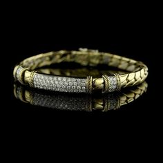We love the details in this 18K yellow gold diamond pave 64 full cut diamonds bracelet!