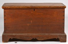 """Paris, Kentucky walnut blanket box or chest in an older surface. Hinged top with simple angled molding, dovetailed case, ogee base molding, bracket feet with serpentine skirt and spur returns. Appears to retain the original lock and hinges. Secondary wood poplar. Second quarter of the 19th century. 14 3/8"""" x 25 1/2"""" x 13 7/8""""."""