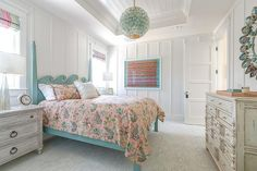 North Shore Bed in a cottage bedroom boasts a lovely turquoise blue ocean wave headboard with gray wood nightstands against floor-to-ceiling board and batten walls.