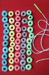 Colorful and educational! Make a (yummy) 100th day of school necklace.