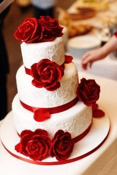 The flowers will be smaller, and the cake topper will be our monogram. But I lo… The flowers will be smaller, and the cake topper will be our monogram. But I love the red against the white icing. Wedding Cake Red, Red Rose Wedding, Beautiful Wedding Cakes, Gorgeous Cakes, Wedding Cake Designs, Pretty Cakes, Amazing Cakes, Wedding Flowers, Yellow Wedding