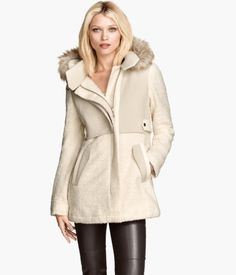 H&M: boucle coat with faux fur on hood. Colors: light beige. Regular Price: $129