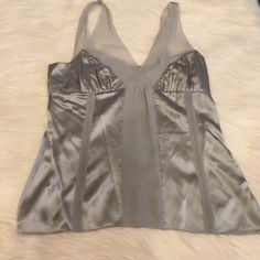 WHITE HOUSE BLACK MARKET GRAY SILK BLOUSE Great condition, 100% silk.  Looks great on its own or with a blazer over it. 34in bust, 24in long. EUC. No stains, pulls, flaws. White House Black Market Tops Camisoles