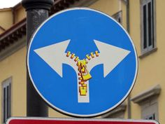 Walking around Livorno I keep finding some more of the traffic signs revised by Clet Abraham . Scali delle Barchette, Livorno Via Mentan.