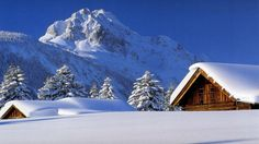 Wooden House In Snow