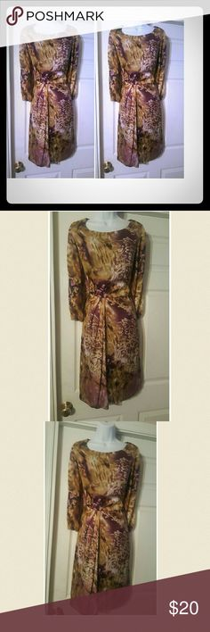 Tan,burgundy &gold ombre print faux wrap dress Beautiful  tan, burgundy and gold faux wrap dress with high round neckline and long sleeves. Dress has never been worn, considered NWOT. Great dress for evening out to dinner or to a business meeting. Dresses