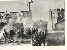 1937- Japanese troops cross bridge that had been set on fire by retreating Chinese just outside the main gate to Tanyang, near Nanking, China.