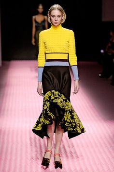Pairing a sweater with a feminine skirt is a big trend this season—Mary does it beautifully with this look.
