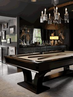 An Office and A Gentleman. A dark elegant billiard room. Interior Designer: Kellie Griffin.