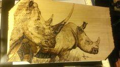 """Rhinos"" woodburning, wood burning, pyrography"