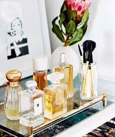 Pretty perfume bottles displayed on a mirrored tray add an elegant feel. | Image: Stacey Brandford / Styling: Stacy Begg