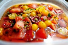A delicious tomato salad marinated in oil, vinegar, and spices. Even better after a couple of days, and makes a delicious bruschetta topping