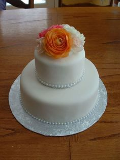 """I think this is the wedding cake style I'm going to go with!  Add a blue satin ribbon around the bottom of both layers and a """"W"""" wedding topper and that's it!"""