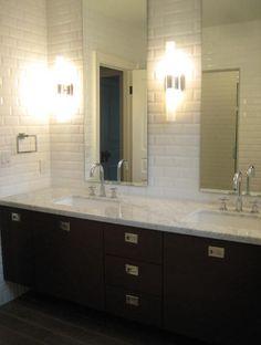 Ferreira Design: Gorgeous black and white bathroom with white beveled subway tile backsplash. A floating ...