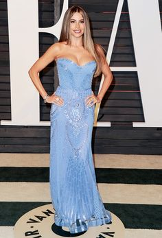 WHO: Sofia Vergara  WEAR: Zuhair Murad sky blue beaded tulle gown; Neil Lane earrings, bracelet, and ring.