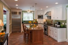i love the green subway tile with the terra cotta floors