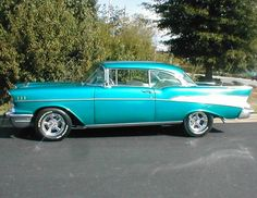 57 Chevy Belair. Love it. My husband drove one in high school. Still have it.