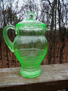 """CAMBRIDGE Glass #3075 VASELINE GREEN Ringed PITCHER Circle Finial  1927 Item condition:-- """"Great Condition! NO chip or cracks!""""; Was:$69.50   Sale Price: $52.12 Glows under a Black Light Circa 1927 Measures: 7.5"""" Tall x 5.25"""" Wide Good Condition. The lid does have a small chip on the underside lip. Displays Great. Would make a great addition to any collection!"""