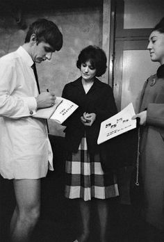 Oh, it's just Ringo...signing autographs in his underwear.