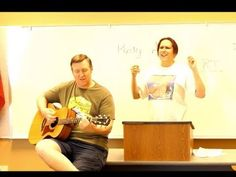 """See YouTube video of Janet Kuypers reading her poem """"It Hurts in the Bones"""", then her poem """"Plutonium"""" from her book """"The Periodic Table of Poetry"""", then covering the Queen song """"Crazy Little Thing Called Love"""" with John on acoustic guitar live 3/10/18 at """"Poetry Aloud"""" (this video was filmed from a Panasonic Lumix 2500 camera)."""