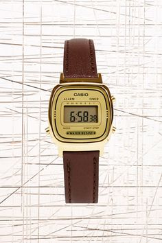 casio leather strap gold face watch from urban outfitters