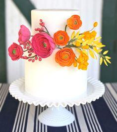 Sweet & Saucy, rainbow floral embellished white wedding cake, pink, orange, yellow