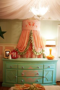 My daughter Addison's bedroom... Whimsical pink velvet tufted headboard, pink tulle ceiling canopy tutorial, ruffled drapery, vintage chic, girl's room, bamboo wood flooring, Sherwin Williams mint green walls