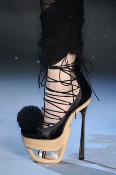 Galliano...louuulouuuu lloue Lou...heel mayb an inch or two too high but Lou it n hers a platform I loue ...I'll take any platform under ball of foot any style so long as it there...heel can b the style as all of uia shoes just higher.