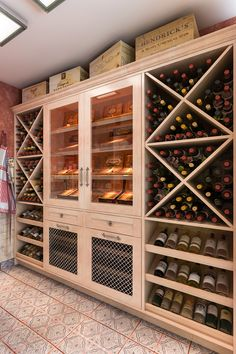 This combination of maple wood and melamine features wine storage in a cross hatch winery style with built in racks and display shelves.