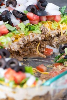 How to Make The Best 7 Layer Dip – Simple Revisions Mexican 7 Layer Taco Dip is a fully customizable appetizer with seasoned beef, refried beans, three types of cheeses, and loaded with your favorite toppings. 7 Layer Mexican Dip, Seven Layer Taco Dip, 7 Layer Bean Dip, Mexican Dip Recipes, Mexican Appetizers, Sausage Appetizers, Taco Dip With Meat, 7 Layer Dip Recipe With Meat, Layered Taco Dip