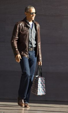 Obama teamed his casual ensemble with a pair of smart brown leather brogues, believed to b...