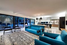 How to Choose and Use Colors in an Open Floor Plan Living Room White, Home Living Room, Living Spaces, Living Area, Teal Rooms, Teal Walls, Sliding Glass Door, Sliding Doors, Teal Sofa