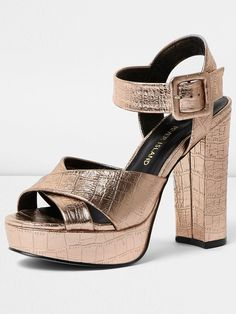 River Island Metallic Platform Sandal Perfect for party season, these platform sandals by River Island will lift your look and turn heads that's for sure! Their gold metallic upper adds the gilded finishing touches to your outfit, while a mock croc print brings a little attitude to your look. Finished withthatblock heel, your look will look effortlessly leggy!Wear with maxi dresses, LBDs and cocktail frocks popping your essentials in a matching gold metallic clutch. Perfect!Premium PU upp...