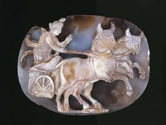 Sardonyx cameo, the empress Julia Domna portrayed as the goddess Luna or Dea Syria, driving a chariot drawn by two bulls