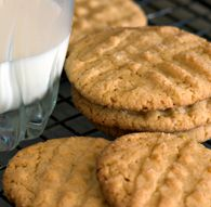 """""""JIFFY"""" Peanut Butter Cookies   (20-24 Cookies)  2 pkgs.""""JIFFY"""" Golden Yellow Cake Mix   1 cup peanut butter   1/2 cup margarine or butter, softened   2 eggs   1/2 tsp. vanilla extract   1/4 cup flour   Preheat oven to 350.   Mix all ingredients until blended.  Roll into 1 balls and place on ungreased baking sheet 1 apart.  Press with fork in a criss-cross pattern.  Bake 10-12 minutes."""