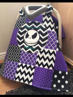Dark Purple and Black Designs Patchwork Nightmare Before Christmas Jack Skellington Baby Car Seat Canopy Cover  Patchwork car seat canopy with Jack Skellington applique/embroidery  Perfect to protect your little ones from cold weather, wind, sun, rain and germs. Fits all car seats, attaches to the car seat handles with snaps. Made with minky and cotton. Machine washable.  We accept Paypal and all credit cards Message me with any questions :)