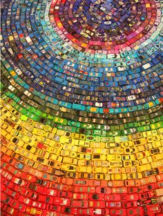 Artist David T Waller used 2500 toy cars to create this stunning round rainbow.