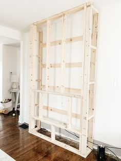 Step by step tutorial on how to build an inexpensive shiplap fireplace using an electric insert. Transform your boring TV wall into a statement piece. Fireplace Tv Wall, Build A Fireplace, Fireplace Built Ins, Faux Fireplace, Fireplace Remodel, Living Room With Fireplace, Fireplace Design, Fireplace Mantels, Farmhouse Fireplace