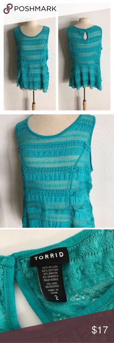 """Torrid lace peplum top Torrid teal lace peplum top. Size 2. Measures 28"""" long with a 42"""" bust. The lace portions are sheer. Very stretchy! Very good used condition. 💲Reasonable offers accepted ✅Bundle offers torrid Tops"""
