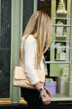 love the purse, the jacket, the jewelry and her hair!  Gosh, I wish my hair was easier to manage!