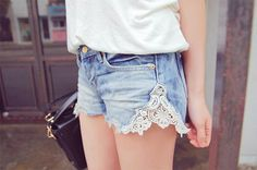 cut old jeans to shorts  - cut triangle out of the side - sew lace on it! ...ready...go!!!