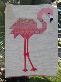 """Florence Flamingo, 20"""" X 28. One block of the pattern by Elizabeth Hartman. Background fabric is natural linen."""