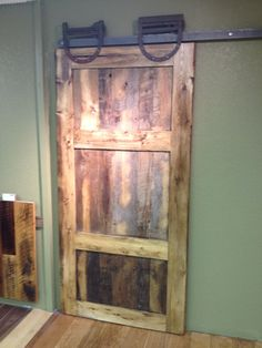 Check out our new reclaimed hardwood barn door in our showroom!  Authentic rustic horseshoe barn door hangers are from ebay.