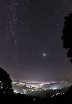 Taurid meteor and Winter Hexagon rising over the town of Kasauli in India,…